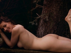 Busty babe Joy posing nude in the garden