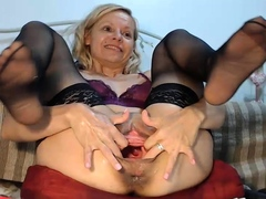 sexy blond transsexual with stockings jerking off