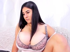 busty-curly-brunette-with-big-boobs-fucks-on-couch