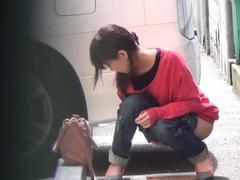 Japanese babe street pees