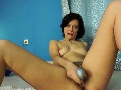 Sexy brunette mom stretches before fully stripping