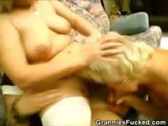 Two Grannies Work On A Cock